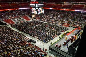 Graduates and their families celebrate during UW-Madison's spring commencement ceremony at the Kohl Center at the University of Wisconsin-Madison on May 13, 2016. The graduation was attended by approximately 900 doctoral, MFA and medical student degree candidates and their guests. (Photo by Bryce Richter / UW-Madison)