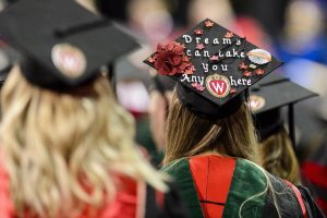 A graduate's decorated mortarboard