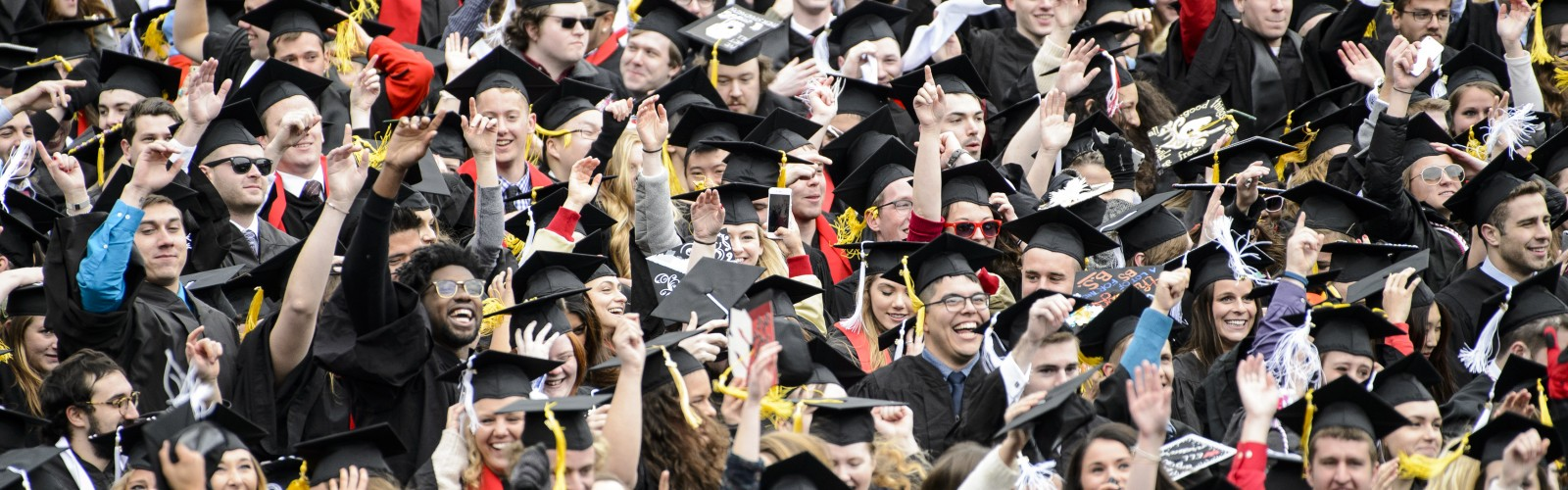 "Graduates dance as the song ""Jump Around"" plays during UW-Madison's spring commencement ceremony at Camp Randall Stadium at the University of Wisconsin-Madison on May 14, 2016. The outdoor graduation was attended by approximately 5,600 bachelor's and master's degree candidates and their guests. (Photo by Bryce Richter / UW-Madison)"
