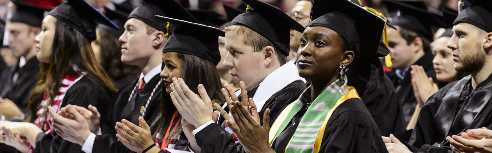 Graduates applaud a speaker during UW-Madison's winter commencement ceremony at the Kohl Center at the University of Wisconsin-Madison on Dec. 20, 2015. The indoor graduation was attended by approximately 1,200 bachelor's and master's degree candidates, plus their guests. (Photo by Jeff Miller/UW-Madison)