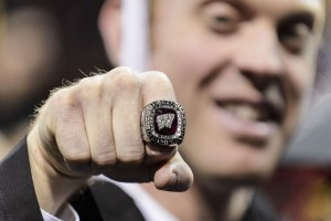 Graduate Quinn Lukens, a former staff member with the volleyball team sports a 2015 women's volleyball Big Ten Championship ring (which all of the team received) during UW-Madison's winter commencement ceremony at the Kohl Center at the University of Wisconsin-Madison on Dec. 20, 2015. The indoor graduation was attended by approximately 1,200 bachelor's and master's degree candidates, plus their guests. (Photo by Jeff Miller/UW-Madison)