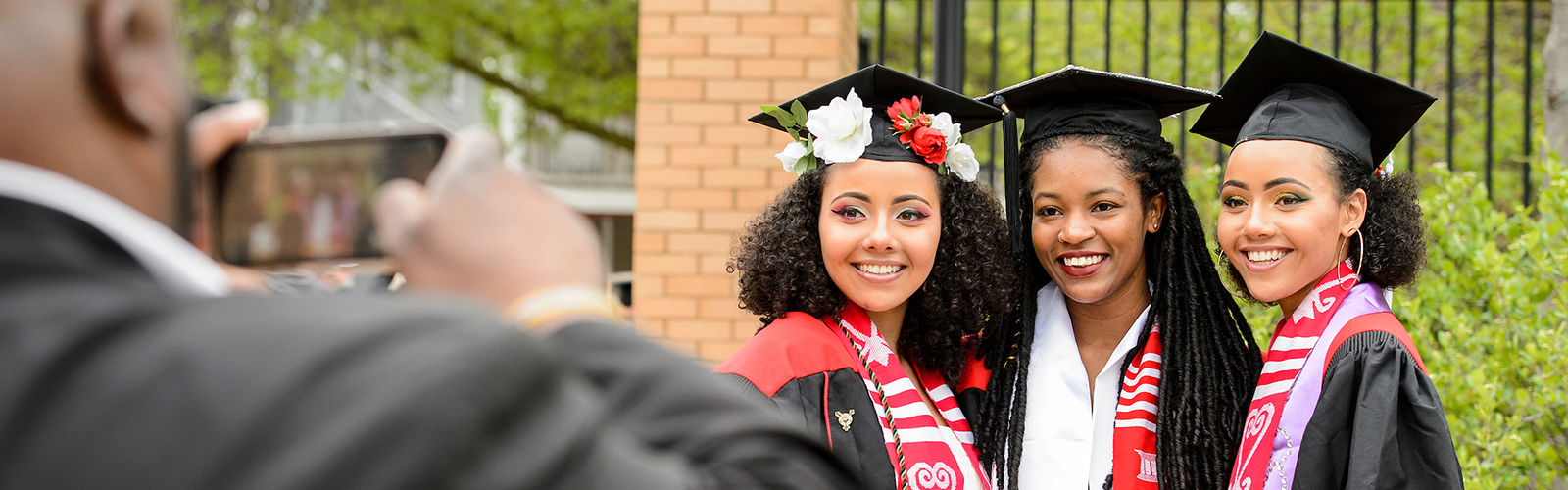 Graduates take a group photo before UW–Madison's spring commencement ceremony at Camp Randall Stadium.